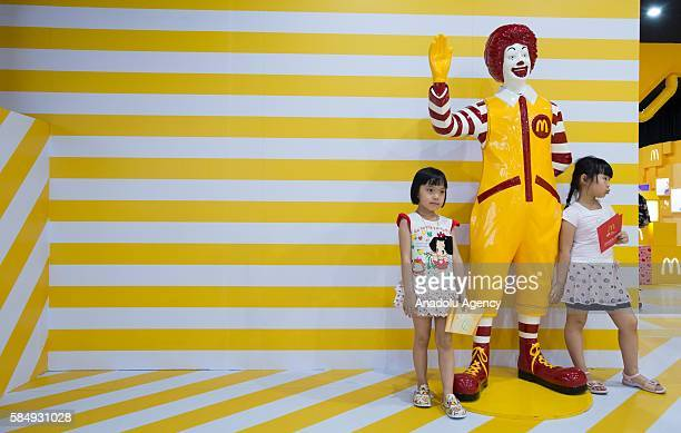 Visitors inspect the toys during the McDonald's toys exhibition at Canton Tower in Guangzhou China on July 31 2016 on the 25th anniversary of the...