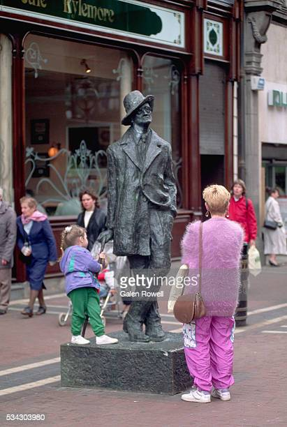 Visitors Inspecting Statue of James Joyce by Marjorie Fitzgibbon
