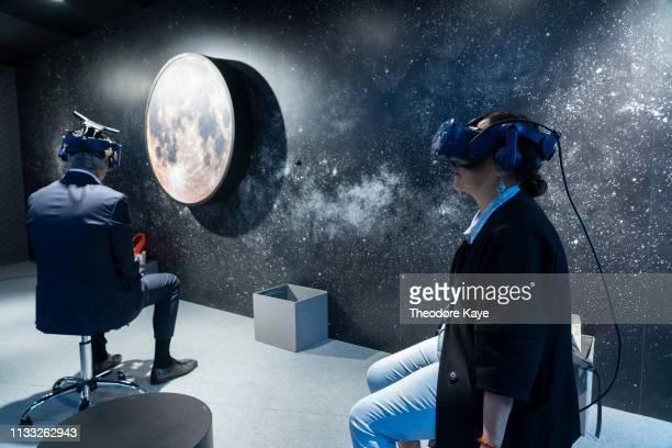 Visitors interact with virtual reality art at Art Basel on March 28, 2019 in Hong Kong, Hong Kong.