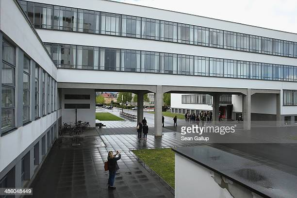 Visitors join a tour of the Bauhaus building also called The Bauhaus Dessau on April 18 2014 in Dessau Germany The Bauhaus building once housed the...