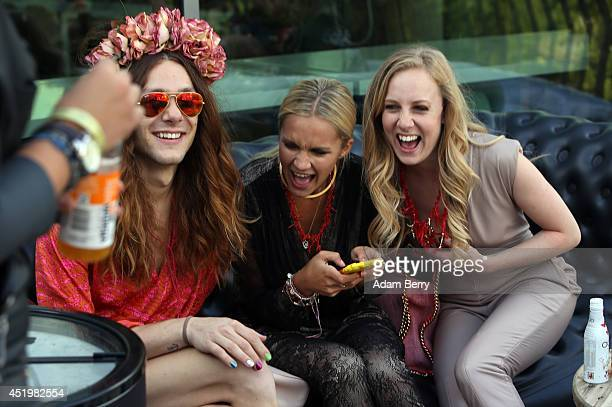 Visitors joke with one another prior to the Holy Ghost show during the MercedesBenz Fashion Week Spring/Summer 2015 at Supermarket Concept Space At...