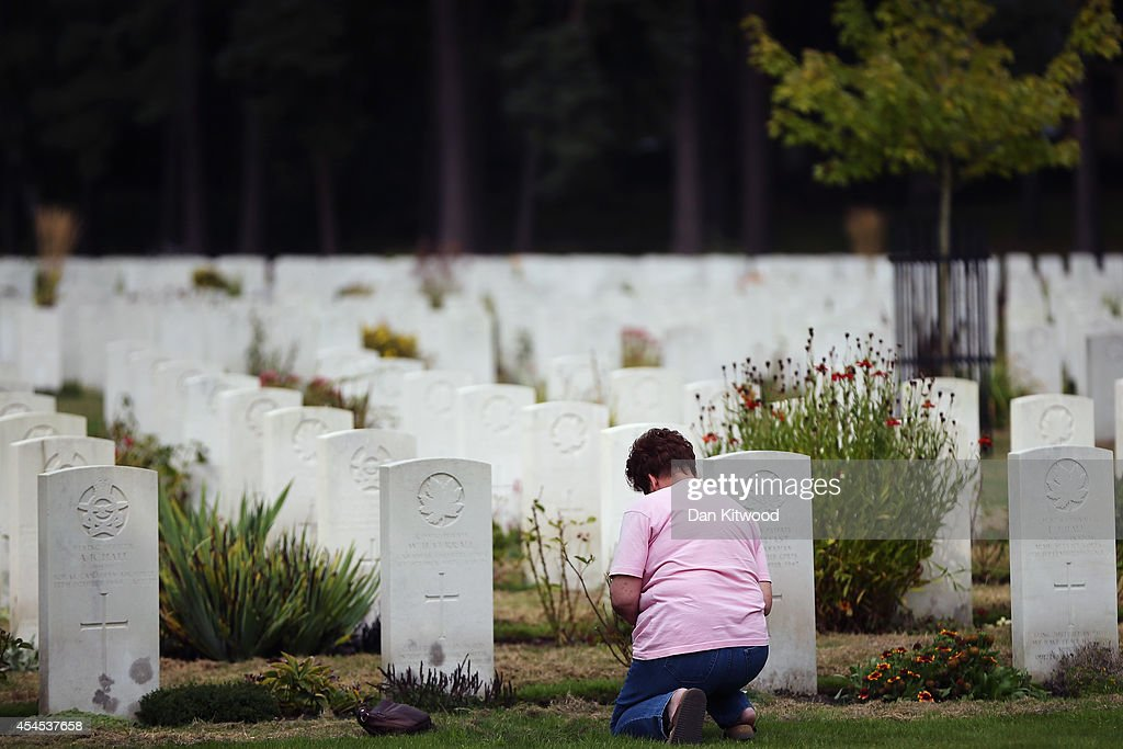 A visitors kneels in front of headstones at the Brookwood Military Cemetery on September 3, 2014 in London, England. Brookwood Military Cemetery in Surrey, is the largest Commonwealth War Cemetery in the UK. Today marks the 75th anniversary of Britain entering the Second World War.