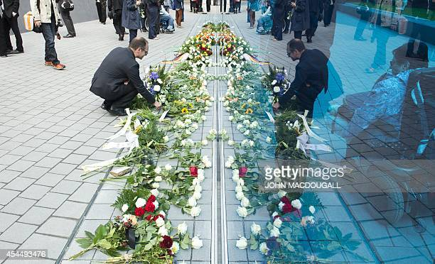 Visitors lay wreaths and flowers at the Memorial for the victims of Nazi euthanasia in Berlin on September 2 2014 during its official inauguration...