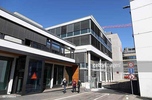 Visitors leave a Sika AG adhesives manufacturing facility in Zurich Switzerland on Monday Sept 7 2015 Sika's founding Burkard family remains...