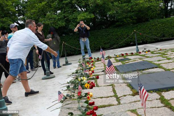 Visitors leave roses at the tomb of President John F Kennedy at Arlington National Cemetery in Arlington Virginia May 29 2017 Today would have marked...