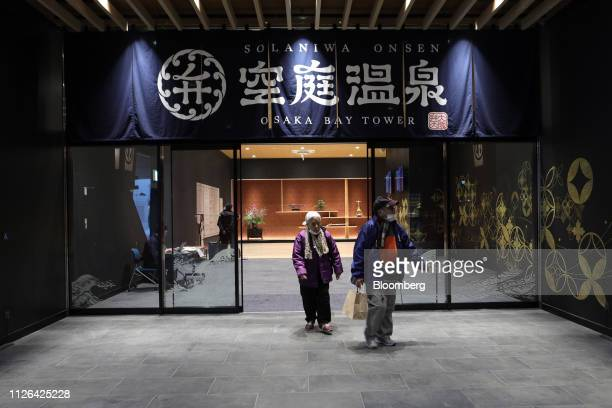 Visitors leave the Solaniwa Onsen spa at Osaka Bay Tower in Osaka, Japan, on Thursday, Feb. 21, 2019. Fortress Investment Group, a unit of SoftBank...