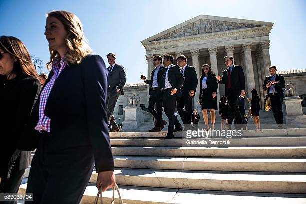 Visitors leave the Supreme Court building on Capitol Hill on June 9 2016 in Washington DC Texas Attorney General Ken Paxton later announced a lawsuit...