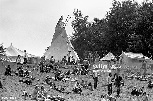 Visitors lie on the grass at the Woodstock Music Art Fair Bethel NY August 15 1969