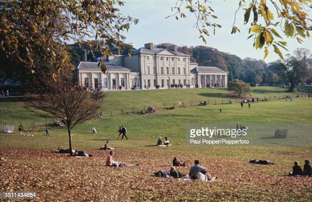 Visitors lie on the grass in front of Kenwood House, a former stately home on the northern edge of Hampstead Heath in Hampstead, London circa 1970....