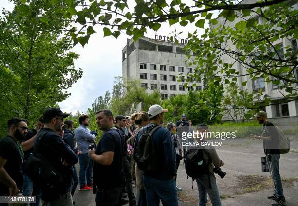 Visitors listen a guide informations in the ghost city of Pripyat during a tour in the Chernobyl exclusion zone on June 7 2019 HBOs hugely popular...