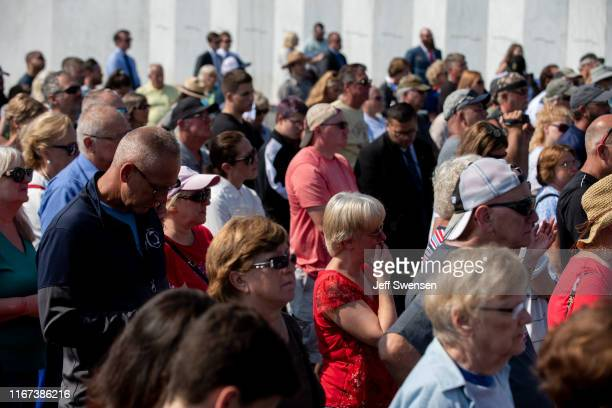 Visitors listen as US Vice President Mike Pence delivers a speech at the Flight 93 National Memorial on September 11 2019 in Shanksville Pennsylvania...