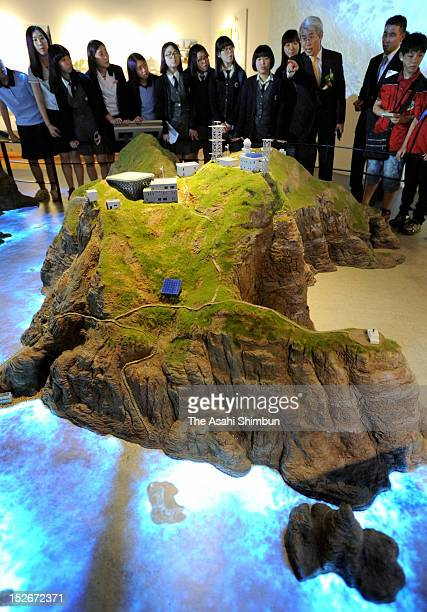 Visitors listen the explanation of Dokdo island during the opening of the 'Dokdo Museum Seoul' on September 14 2012 in Seoul South Korea Both South...