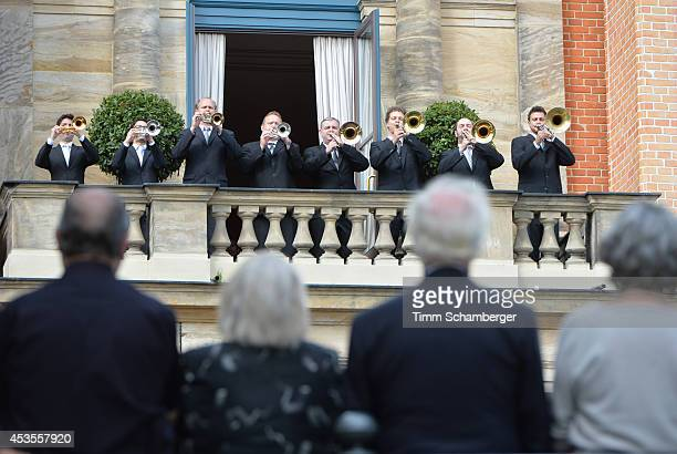 Visitors listen to the Fanfare at Bayreuth Festival Theatre on August 12, 2014 in Bayreuth, Germany.