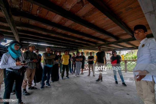 Visitors listen to the guide's explanation of Banua Oge or Souraja in Palu Central Sulawesi Indonesia Sunday 3 February 2019 The house that was built...