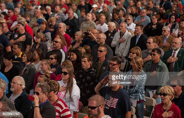 Visitors listen to the National Anthem at the Flight 93 National Memorial on the 15th Anniversary ceremony of the September 11th terrorist attacks...