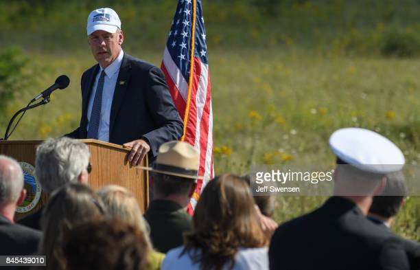 Visitors listen to US Secretary of the Interior Ryan Zinke at the groundbreaking of the Tower Of Voices at the Flight 93 National Memorial on the...