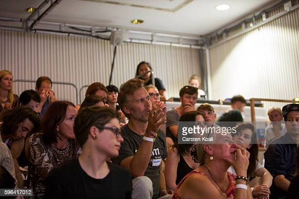 Visitors listen while Jacqueline Bourke of Getty Images speaks during the EyeEm photofestival at Heimathafen Neukoelln on August 27 2016 in Berlin...