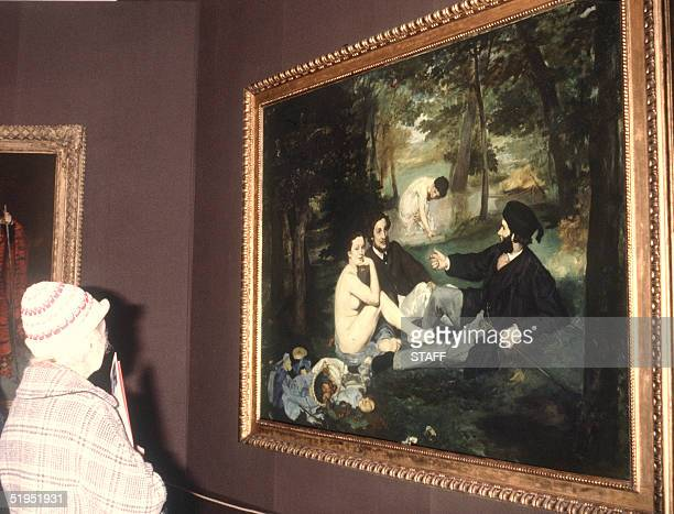 Visitors look 22 April 1983 at famous 'DTjevner sur l'herbe' painted by French Edouard Manet one of his famous paintings proposed in a great...