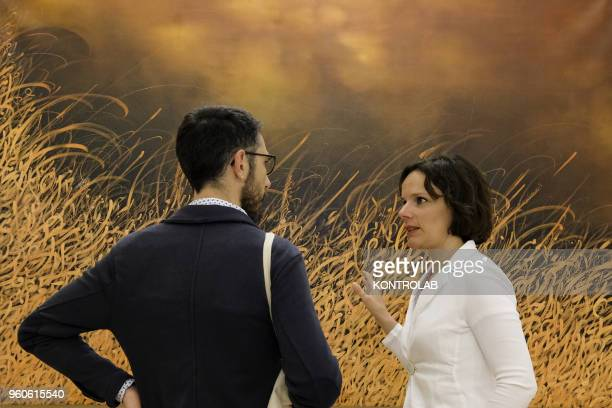 PIEMONTE SALUZZO CUNEO ITALY Visitors look a painting of Iranian artist Alireza Karimpour during the opening of exhibition Diario Persiano at...