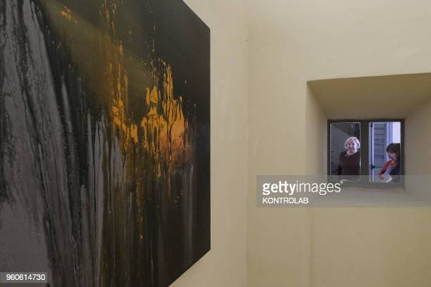 PIEMONTE SALUZZO CUNEO ITALY Visitors look a painting of Iranian artist Amir Bakhtiar Panjabiduring the opening of exhibition Diario Persiano at...