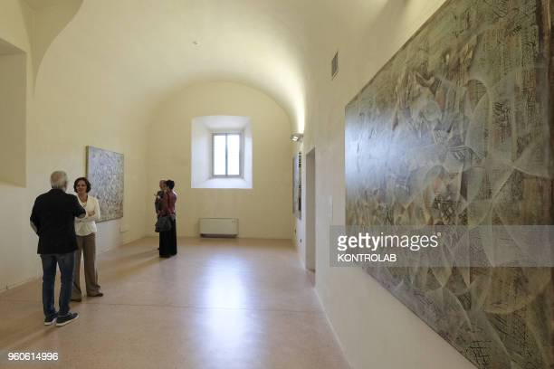 PIEMONTE SALUZZO CUNEO ITALY Visitors look a painting of Iranian artist Firoozeh Akhlaghi during the opening of exhibition Diario Persiano at...