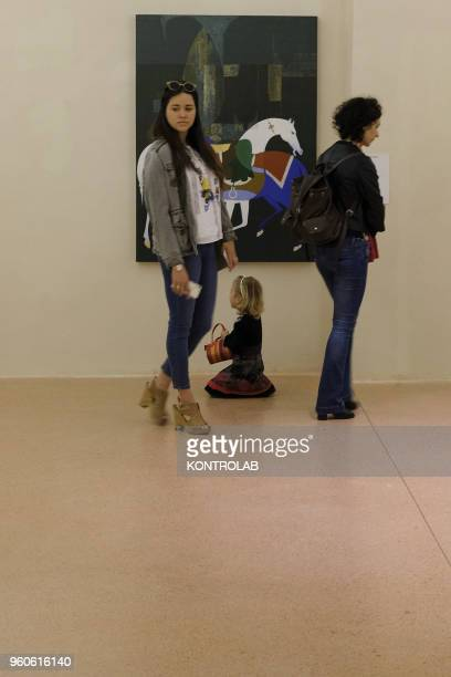 PIEMONTE SALUZZO CUNEO ITALY Visitors look a painting of Iranian artist Mohamad Hadi Fadavi during the opening of exhibition Diario Persiano at...