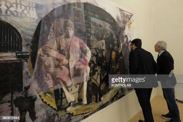 PIEMONTE SALUZZO CUNEO ITALY Visitors look a painting of Iranian artist Sahar Salehi during the opening of exhibition Diario Persiano at Castiglia...