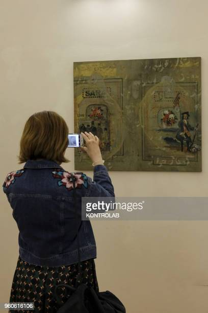 PIEMONTE SALUZZO CUNEO ITALY Visitors look a painting of Iranian artist Shahram Karimi during the opening of exhibition Diario Persiano at Castiglia...
