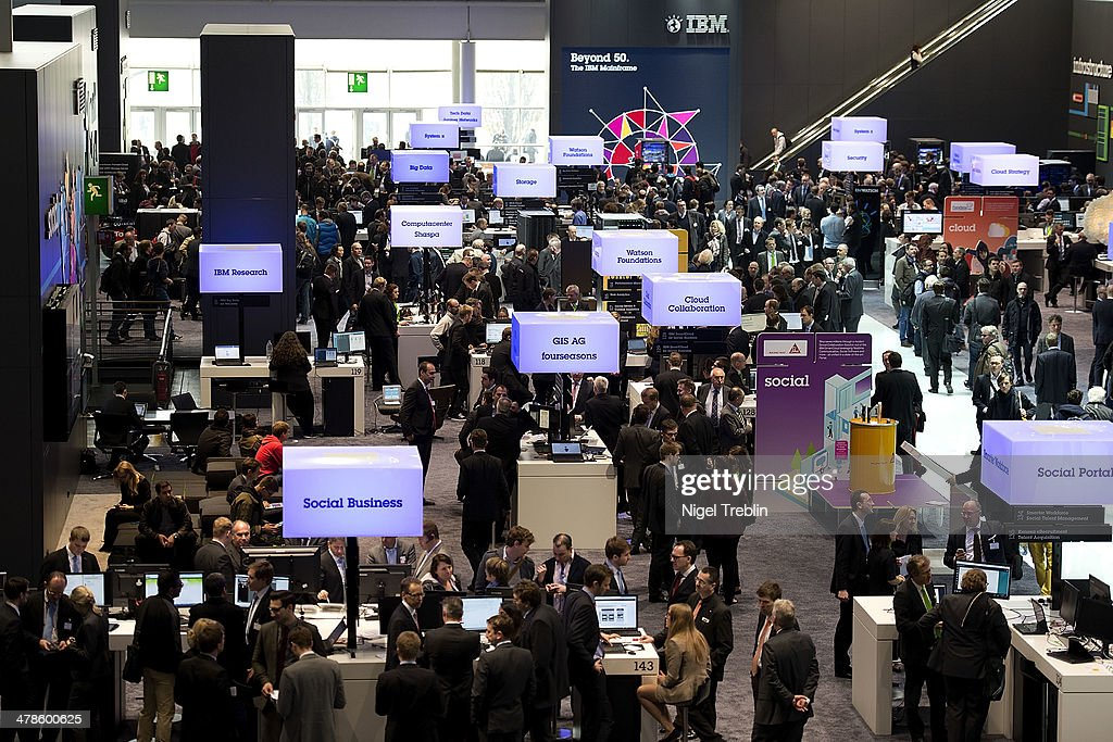 Visitors look arround at the IBM stand at the 2014 CeBIT technology Trade fair on March 14, 2014 in Hanover, Germany. CeBIT is the world's largest technology fair and this year's partner nation is Great Britain.