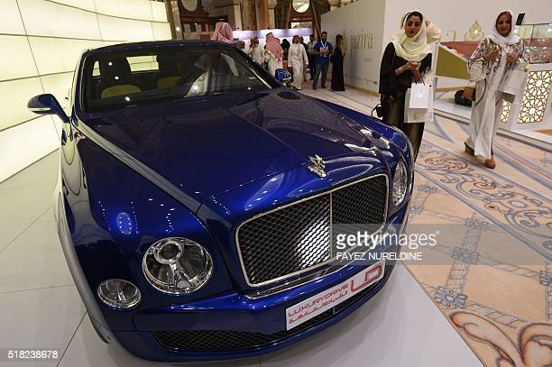 Visitors look at a Bentley luxury car displayed during the 2016 World Luxury Expo Riyadh 2016 held at the RitzCarlton hotel in the capital Riyadh on...