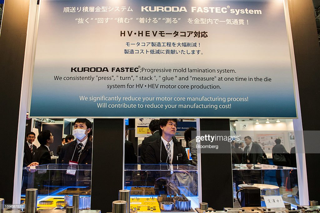 Visitors look at a booth displaying Kuroda Precision Industries Ltd.'s Fastec system at Automotive World 2013 in Tokyo, Japan, on Friday, Jan. 18, 2013. The Automotive World 2013 trade show ends today. Photographer: Noriko Hayashi/Bloomberg via Getty Images