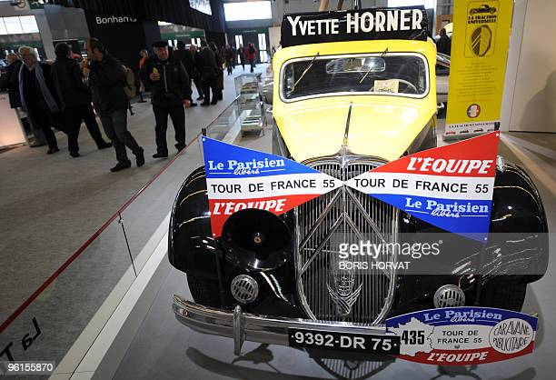 Visitors look at a Citroen Traction used By French Accordionist Yvette Horner during the cycling race Tour De France 1955 is displayed at Paris...