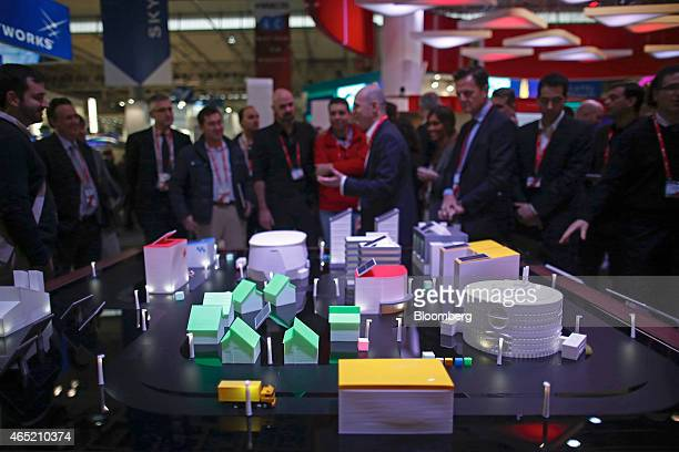 Visitors look at a demonstration display of a 'smart city' at the Mobile World Congress in Barcelona Spain on Wednesday March 4 2015 The event which...