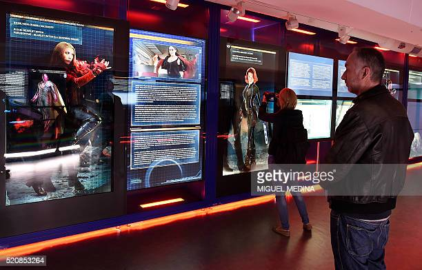 Visitors look at a display on Marvel Comics superheros Scarlet Witch and Black Widow at the interactive Marvel Avengers STATION exhibition in the...