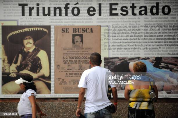 STORY Visitors look at a huge banner in the destroyed mansion of drug trafficker Pablo Escobar inside the Napoles ranch thematic park in Puerto...