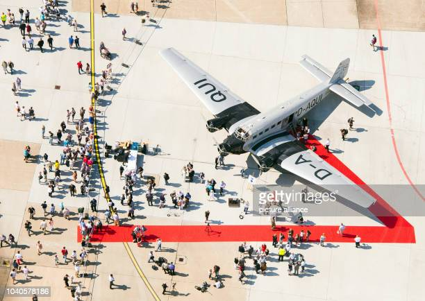 Visitors look at a Junkers Ju 52 aircraft also known as 'Tante Ju' on display during the exhibition 'Airport Days'at Fuhlsbuettel Airport in...
