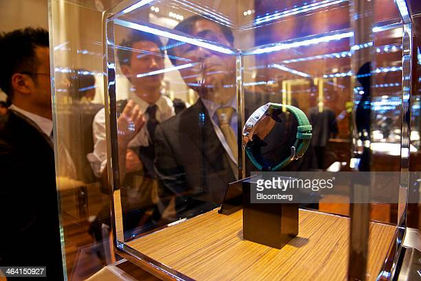 Visitors look at a luxury wristwatch manufactured by Panerai a watchmaking unit of Cie Financiere Richemont SA on display at the Salon International...