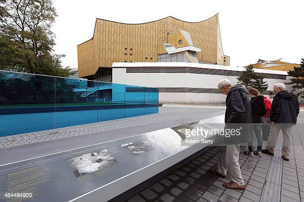 Visitors look at a monument dedicated to the over 200000 victims of the euthanasia program used by Hitler's National Socialist government to kill...