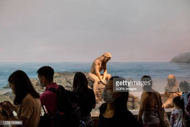 Visitors look at a Neolithic-themed scene at the Hong Kong museum of History. The permanent exhibition of the museum will close on 19 October 2020...