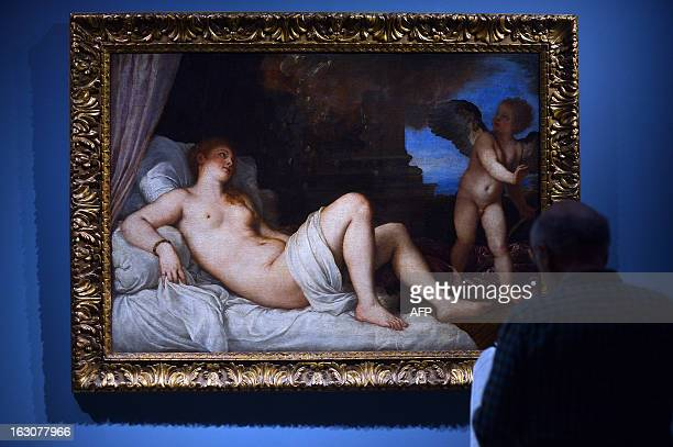 Visitors look at a painting by Renaissance master Titian during a preview of the Tiziano exhibition at the Scuderie del Quirinale on March 4 2013 in...