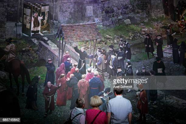 Visitors look at a panoramapainting which shows the town of Wittenberg 500 years ago in the year 1517 on May 20 2017 in Wittenberg Germany Wittenberg...