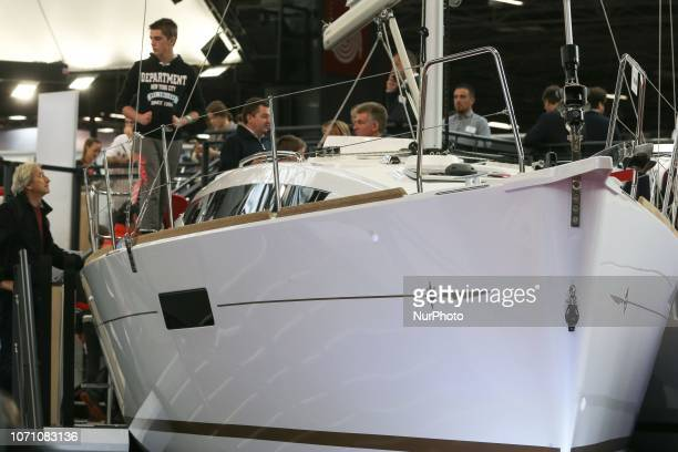 Visitors look at a sailing boat of the French yacht manufacturer Dufour during the Paris International Boat Show on December 9 2018 at the Porte de...