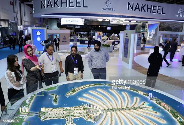Visitors look at a scale model of Palm Jumeirah during Cityscape Global at Dubai World Trade Centre on September 12 2017 in Dubai United Arab Emirates