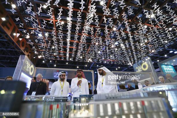 Visitors look at a scale model of the Expo Dubai 2020 project during Cityscape Global at Dubai World Trade Centre on September 11 2017 in Dubai...