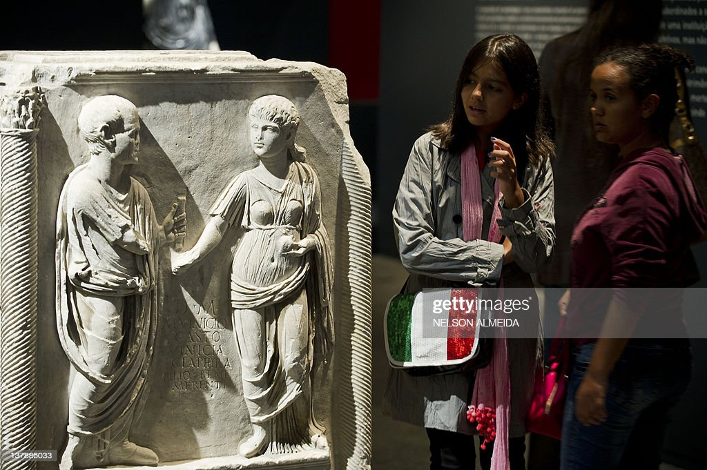 Visitors look at a sculpture displayed a : News Photo