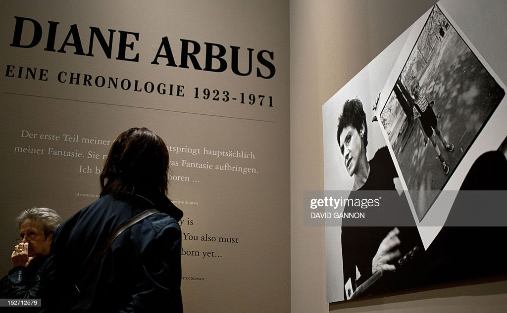 Visitors look at a the work of US photographer Diane Arbus on show at an exhibition at the Martin-Gropius-Bau in Berlin, on September 24, 2012, the final day of the three-month-long retrospective.