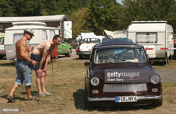 Visitors look at a Trabant automobile at a Trabant enthusiasts' weekend on August 8 2015 near Nossen Germany The Trabant also called the Trabi is the...