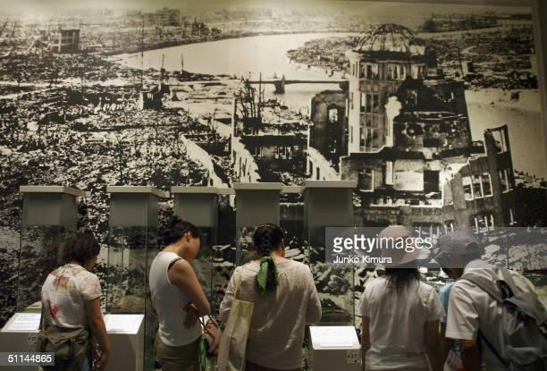 Visitors look at a view of the area surrounding the Atomic Bomb Dome pictured after the atomic bomb was dropped August 5 2004 in Hiroshima Japan...