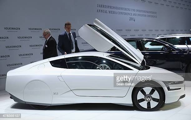 Visitors look at a Volkswagen XL 1 hybrid car prior to the company's annual press conference to announce financial results for 2013 on March 13 2014...