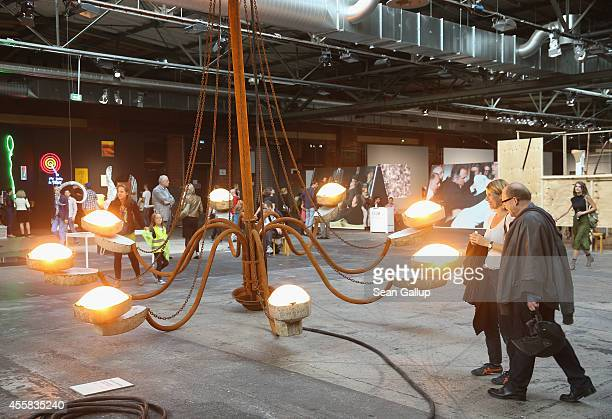 """Visitors look at a work by Kristof Kintera at the """"art berlin contemporary"""" art trade fair at The Station on September 20, 2014 in Berlin, Germany...."""